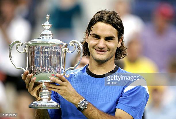 Roger Federer of Switzerland holds his trophy after winning the men's final over Lleyton Hewitt of Australia with a score of 60 76 60 in the men's...