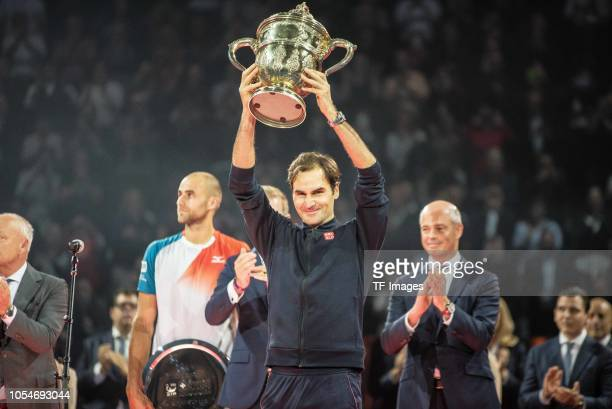 Roger Federer of Switzerland holds his trophy during the presentation ceremony of the Swiss Indoors Basel tennis tournament at St Jakobshalle on...