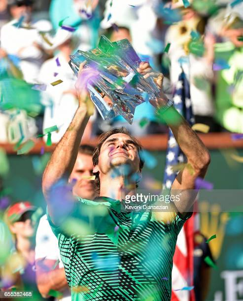 Roger Federer of Switzerland holds the BNP Paribas Open trophy after his straight sets victory against Stanislas Wawrinka of Switzerland in the mens...
