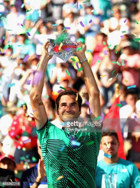 Roger Federer of Switzerland holds the BNP Paribas Open trophy aloft after his straight sets victory against Stanislas Wawrinka of Switzerland in the...