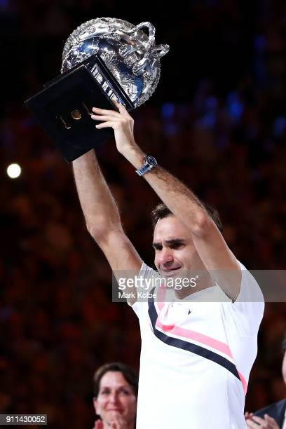Roger Federer of Switzerland holds the Norman Brookes Challenge Cup after winning the 2018 Australian Open Men's Singles Final against Marin Cilic of...