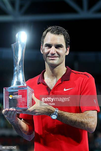 Roger Federer of Switzerland holds the Roy Emerson trophy after winning his 1000th single title after the Mens final match against Milos Raonic of...
