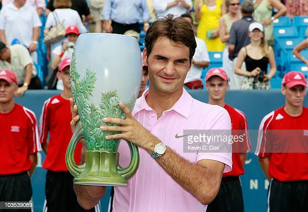 Roger Federer of Switzerland holds the trophy after defeating Mardy Fish during the finals on Day 7 of the Western Southern Financial Group Masters...