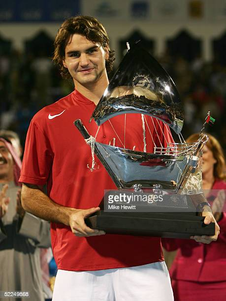 Roger Federer of Switzerland holds the trophy after victory over Ivan Ljubicic of Croatia in the Singles Final of the Dubai Duty Free Men's Open...