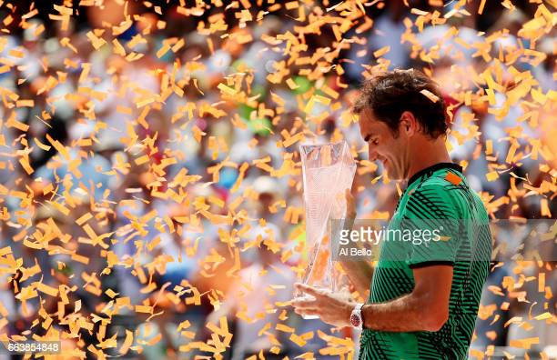Roger Federer of Switzerland holds the winner's trophy after defeating Rafael Nadal of Spain during the Men's Final and day 14 of the Miami Open at...