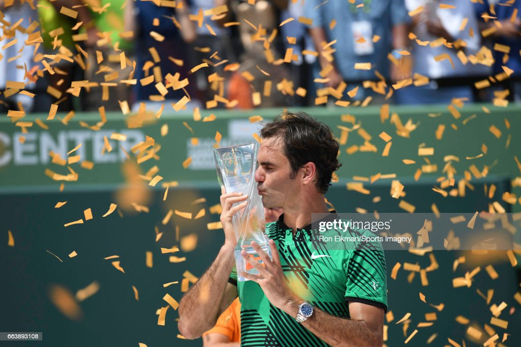 Roger Federer of Switzerland holds the winner's trophy after defeating Rafael Nadal of Spain during the Men's Final on day 14 of the Miami Open at Crandon Park Tennis Center on April 2, 2017 in Key Biscayne, Florida.