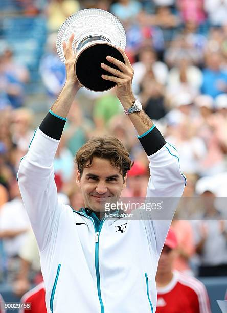 Roger Federer of Switzerland holds the winners trophy aloft after defeating Novak Djokovic of Serbia in the Singles Final during day seven of the...