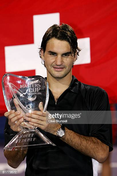 Roger Federer of Switzerland holds up the trophy after defeating Lleyton Hewitt of Australia in the men's final with the score of 63 62 at the Tennis...