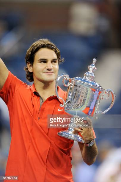 Roger Federer of Switzerland holds up the US Open trophy after defeating Andy Murray of the United Kingdom in the 2008 US Open Men's Championship...
