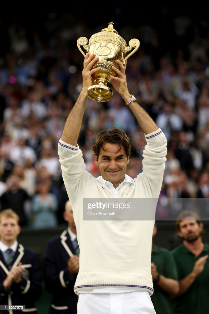 Roger Federer of Switzerland holds up the winner's trophy after winning his Gentlemen's Singles final match against Andy Murray of Great Britain on day thirteen of the Wimbledon Lawn Tennis Championships at the All England Lawn Tennis and Croquet Club on July 8, 2012 in London, England.