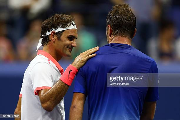 Roger Federer of Switzerland hugs Stan Wawrinka of Switzerland after their Men's Singles Semifinals match on Day Twelve of the 2015 US Open at the...