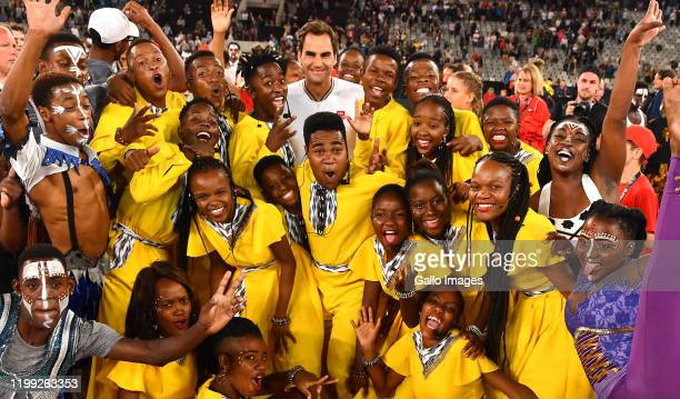 Roger Federer of Switzerland hugs the kids after the Match in Africa between Roger Federer and Rafael Nadal at Cape Town Stadium on February 07 2020...