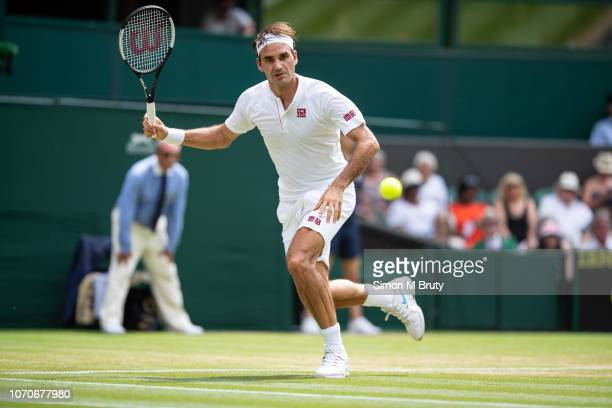 Roger Federer of Switzerland in action against Adrian Mannarino of France during The Wimbledon Lawn Tennis Championship at the All England Lawn...