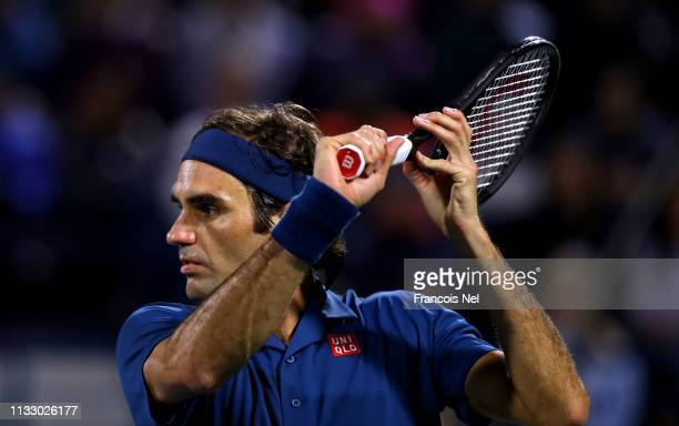 Roger Federer of Switzerland in action against Borna Coric of Croatia during in his men's semi final match on day thirteen of the Dubai Duty Free...