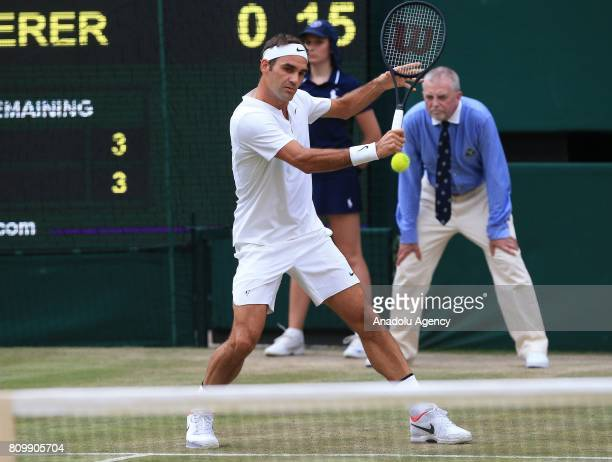 Roger Federer of Switzerland in action against Dusan Lajovic of Serbia on day four of the 2017 Wimbledon Championships at the All England Lawn and...