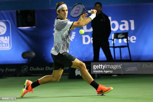 Roger Federer of Switzerland in action against Evgeny Donskoy of Russia during their men's singles second round match of Dubai Duty Free Tennis...