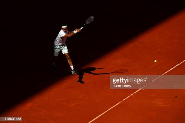 Roger Federer of Switzerland in action against Gael Monfils of France during day six of the Mutua Madrid Open at La Caja Magica on May 09 2019 in...