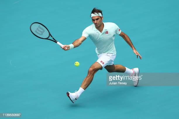 Roger Federer of Switzerland in action against John Isner of USA in the final during day fourteen of the Miami Open tennis on March 31 2019 in Miami...