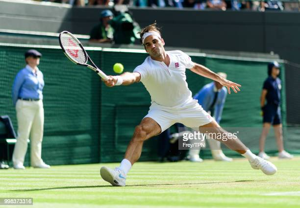 Roger Federer of Switzerland in action against Kevin Anderson of South Africa in the gentlemen's quarter finals at the All England Lawn Tennis and...