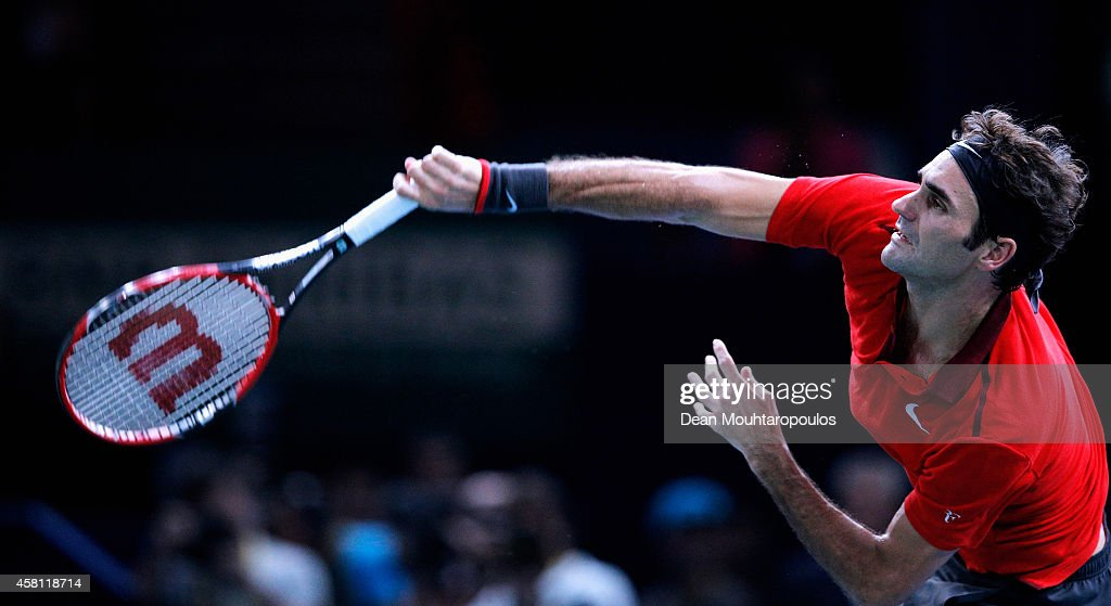 Roger Federer of Switzerland in action against Lucas Pouille of France during day 4 of the BNP Paribas Masters held at the at Palais Omnisports de Bercy on October 30, 2014 in Paris, France.