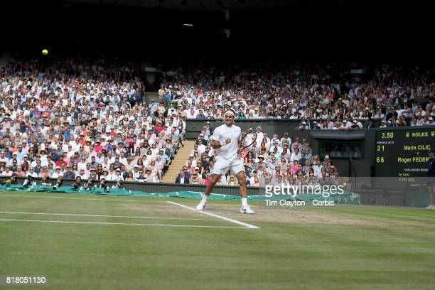 Roger Federer of Switzerland in action against Marin Cilic of Croatia during the Gentlemen's Singles final of the Wimbledon Lawn Tennis Championships...