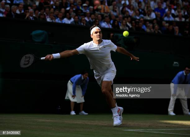 Roger Federer of Switzerland in action against Milos Raonic of Canada on day nine of the 2017 Wimbledon Championships at the All England Lawn and...