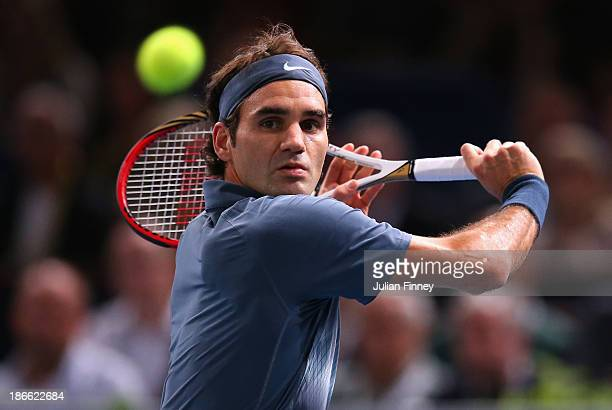 Roger Federer of Switzerland in action against Novak Djokovic of Serbia during day six of the BNP Paribas Masters at Palais Omnisports de Bercy on...