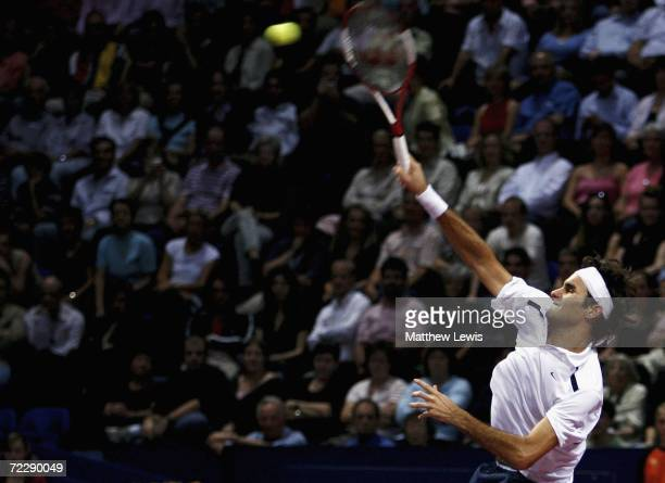 Roger Federer of Switzerland in action against Paradorn Srichaphan of Thailand during day five of the ATP Davidoff Swiss Indoors Tournament at...