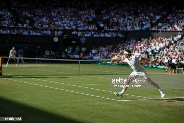 Roger Federer of Switzerland in action against Rafael Nadal of Spain during the Men's Singles Semifinals on Centre Court during the Wimbledon Lawn...