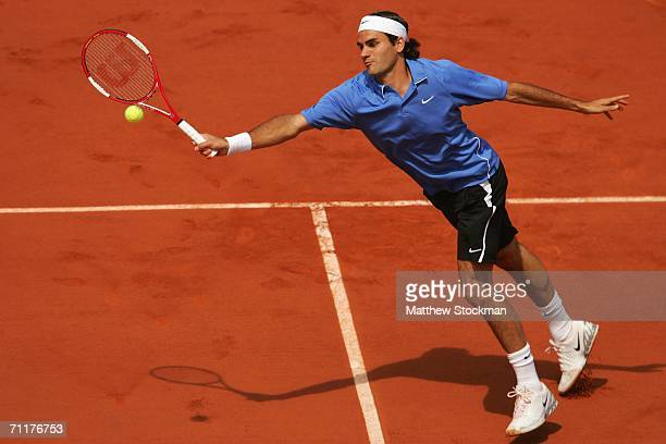 Roger Federer of Switzerland in action against Rafael Nadal of Spain during the Mens Singles Final on day fifteen of the French Open at Roland Garros...
