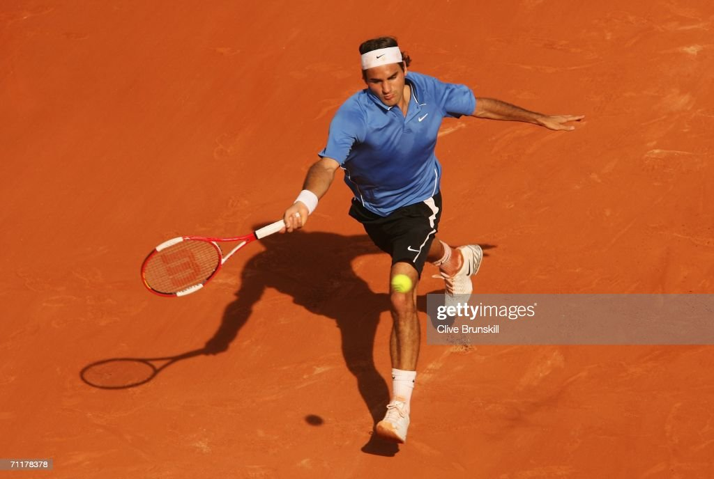 Roger Federer of Switzerland in action against Rafael Nadal of Spain during the Men's Singles Final on day fifteen of the French Open at Roland Garros on June 11, 2006 in Paris, France.