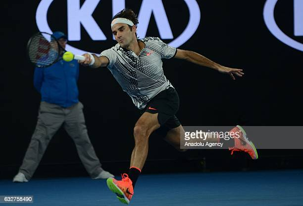 Roger Federer of Switzerland in action against Stan Wawrinka of Switzerland during their men's singles semifinal match on day 11 of the 2017...