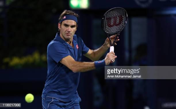 Roger Federer of Switzerland in action against Stefanos Tsitsipas of Greece during day Fourteen of the Dubai Duty Free Tennis Stadium on at Dubai...