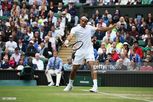 Roger Federer of Switzerland in action during his Gentlemen's Singles second round match against Gilles Muller of Luxembourg on day four of the...