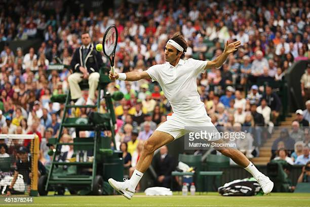 Roger Federer of Switzerland in action during his Gentlemen's Singles third round match against Santiago Giraldo of Colombia on day six of the...