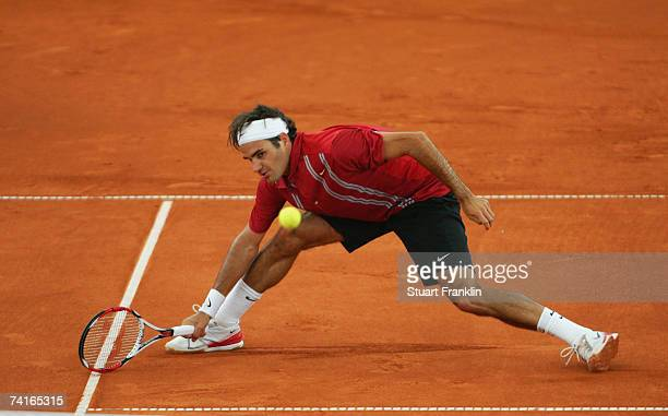 Roger Federer of Switzerland in action during his match against Juan Monaco of Argentina during day three of the Tennis Masters Series Hamburg at...