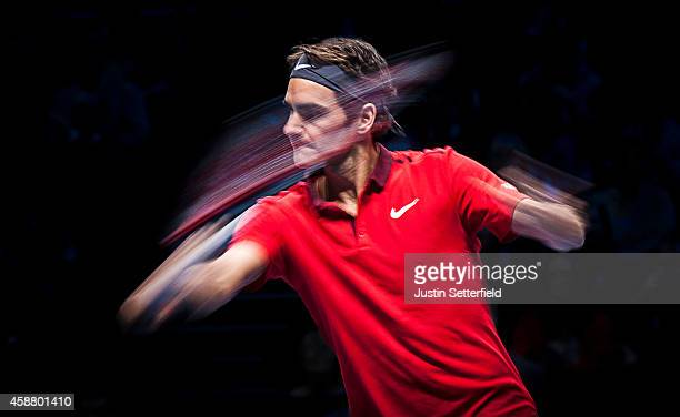 Roger Federer of Switzerland in action during the round robin singles match against Kei Nishikori of Japan on day three of the Barclays ATP World...