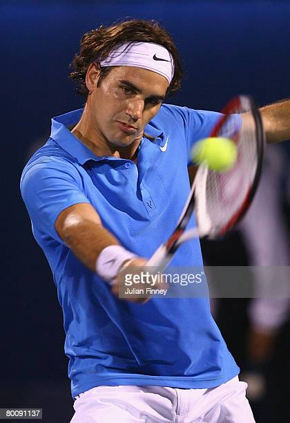 Roger Federer of Switzerland in action in his match against Andy Murray of Great Britain pose for photos before their match during the ATP Barclays...
