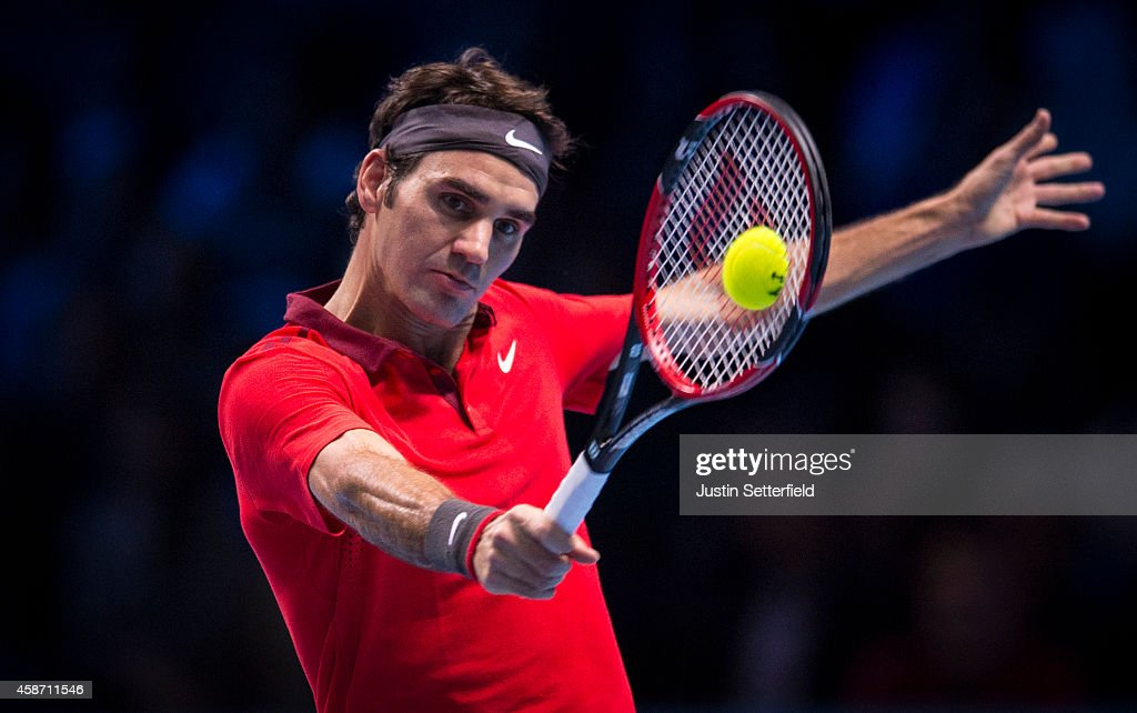 Roger Federer of Switzerland in action in his match against Milos Raonic of Canada in the round robin during day one of the Barclays ATP World Tour Finals tennis at O2 Arena on November 9, 2014 in London, England.