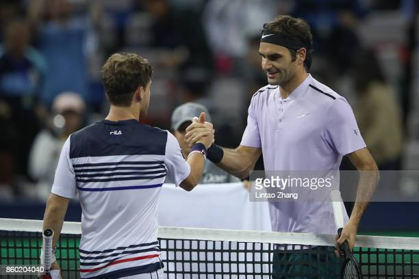 Roger Federer of Switzerland is congratulated by Diego Schwartzman of Argentina after winning the Men's singles mach second round on day four of 2017...