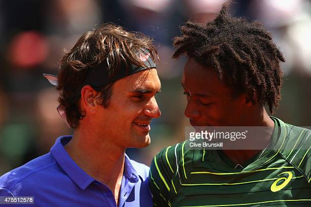 Roger Federer of Switzerland is congratulated by Gael Monfils of France after their Men's Singles match on day nine of the 2015 French Open at Roland...