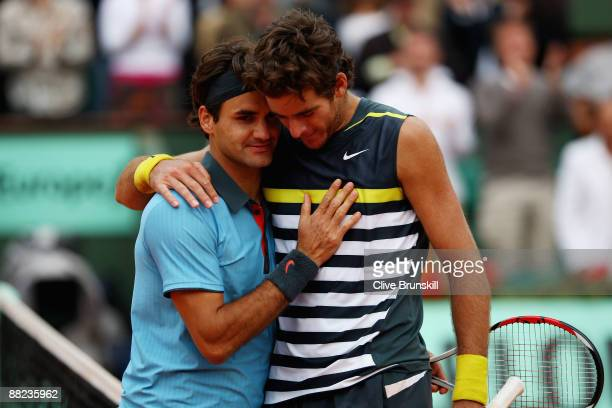Roger Federer of Switzerland is congratulated by Juan Martin Del Potro of Argentina following his victory during the Men's Singles Semi Final matchon...
