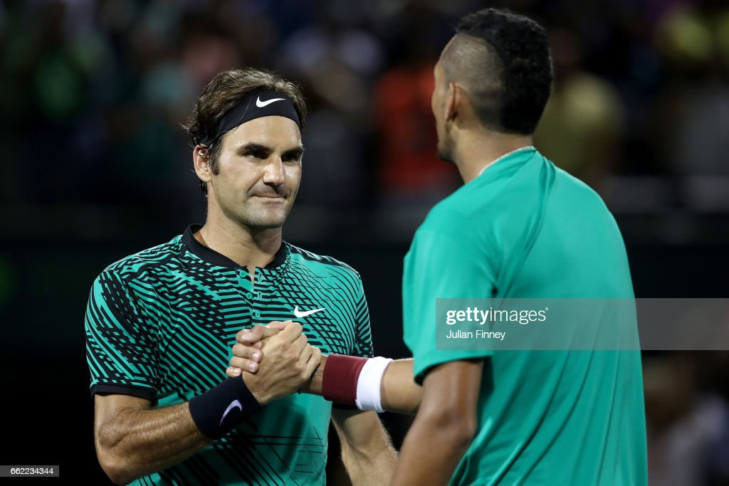 Roger Federer of Switzerland is congratulated by Nick Kyrgios of Australia after his three sets win in the semi finals at Crandon Park Tennis Center on March 31, 2017 in Key Biscayne, Florida.
