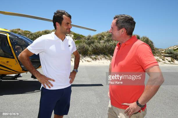 Roger Federer of Switzerland is greeted by Western Australian Premier Mark McGowan on arrival at Rottnest Island ahead of the 2018 Hopman Cup on...