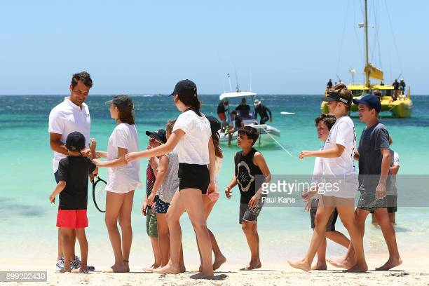 Roger Federer of Switzerland is greeted on the beach by children after arriving at Rottnest Island ahead of the 2018 Hopman Cup on December 28 2017...