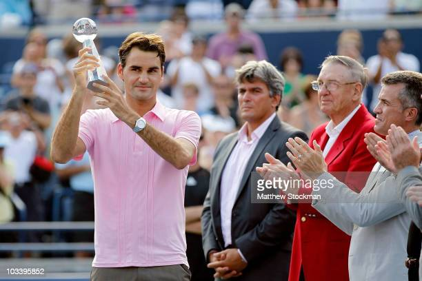 Roger Federer of Switzerland is presented the runnerup trophy after loosing to Andy Murray of Great Britain during the final of the Rogers Cup at the...