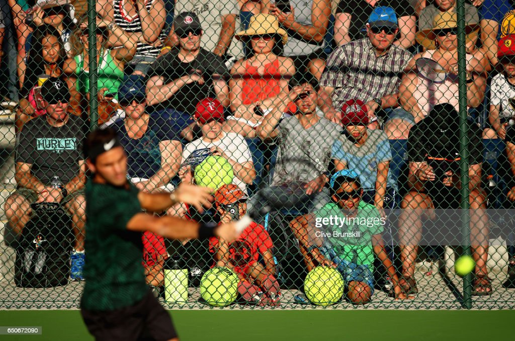 Roger Federer of Switzerland is watched by a wall of fans as he hits during a practice session on day four of the BNP Paribas Open at Indian Wells Tennis Garden on March 9, 2017 in Indian Wells, California.