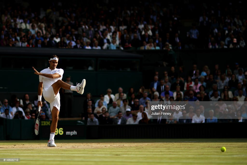 Roger Federer of Switzerland kicks a ball as he reacts during the Gentlemen's Singles semi final match against Tomas Berdych of The Czech Republic on day eleven of the Wimbledon Lawn Tennis Championships at the All England Lawn Tennis and Croquet Club at Wimbledon at Wimbledon on July 14, 2017 in London, England.