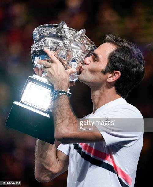Roger Federer of Switzerland kisses the Norman Brookes Challenge Cup after winning the 2018 Australian Open Men's Singles Final against Marin Cilic...