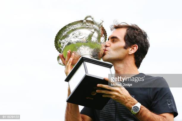 Roger Federer of Switzerland kisses the Norman Brookes Challenge Cup after winning the 2018 Australian Open Men's Singles Final at Government House...